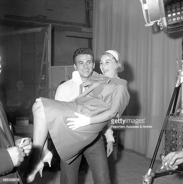Italian actor and director Walter Santesso holding Italian actress Alessandra Panaro in a scene from the film Avventura a Capri Capri 1958