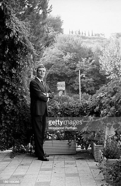 Italian actor and dubber Franco Volpi standing with folded arms on the terrace of his house Rome 1966