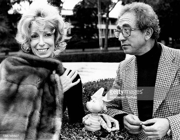 Italian actor and dubber Peppino Mazzullo and Italian artist and puppets designer Maria Perego joking with the puppet Topo Gigio Peppino Mazzullo is...