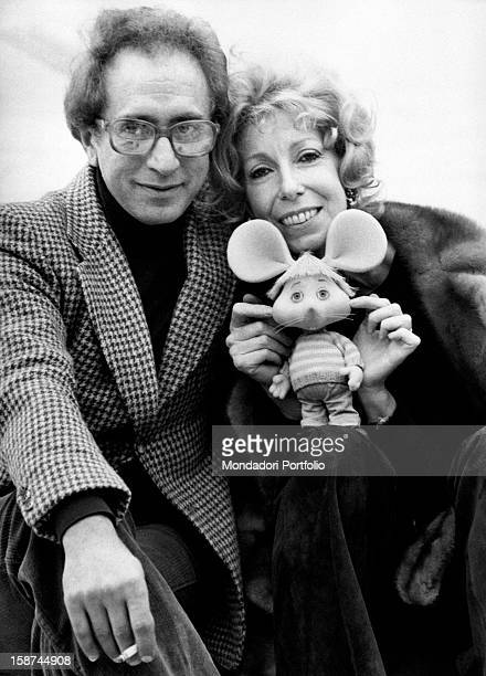 Italian actor and dubber Peppino Mazzullo sitting beside Italian artist and puppets designer Maria Perego with the puppet Topo Gigio in her hands...