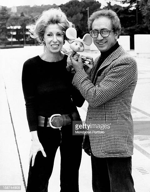 Italian actor and dubber Peppino Mazzullo smiling beside Italian artist and puppets designer Maria Perego with the puppet Topo Gigio in her hands...
