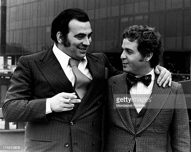 Italian actor and energy healer Maurizio Arena talking with Italian actor Renato Pozzetto in the film To love Ophelia Rome 1974