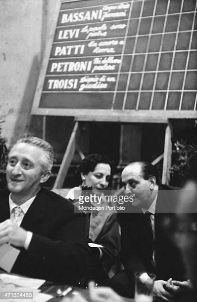 Italian actor and entrepreneur Guido Alberti attending the 10th Strega Prize with Italian writer and translator Maria Bellonci On the board behind...
