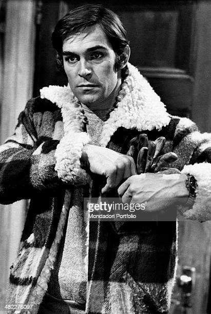 Italian actor and singer Fabio Testi putting the gloves into the jacket poket in the film Last Chance. Rome, 1973