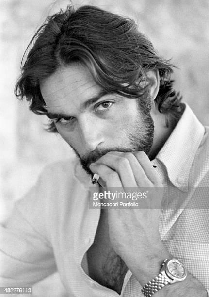 Italian actor and singer Fabio Testi smoking a cigarette. Peschiera del Garda, 1971