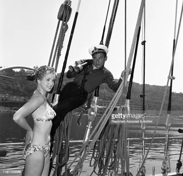 Italian actor and singersongwriter Renato Rascel looking in a binocular at American actress Natalie Trundy in the film The Monte Carlo Story Monte...