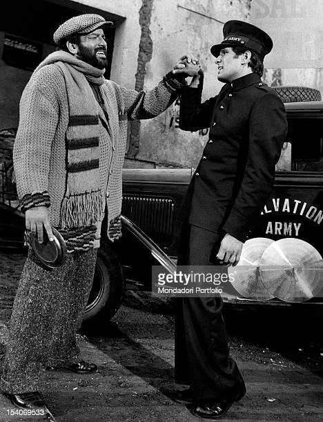 Italian actor and swimmer Bud Spencer squeezing in his hand the Italian actor Giuliano Gemma's fist in Even Angels Eat Beans Rome 1973