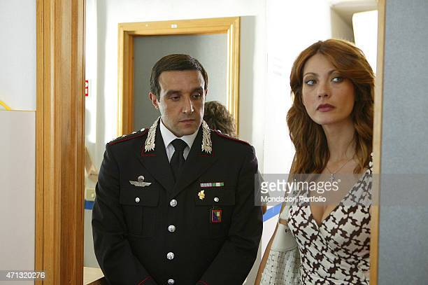 Italian actor and Tv presenter Flavio Insinna and Italian actress and showgirl Milena Miconi playing the Captain of Carabinieri and the maior of the...