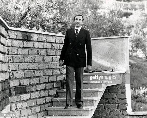 Italian actor and TV presenter Pippo Baudo going down a staircase and smiling Morlupo 1974