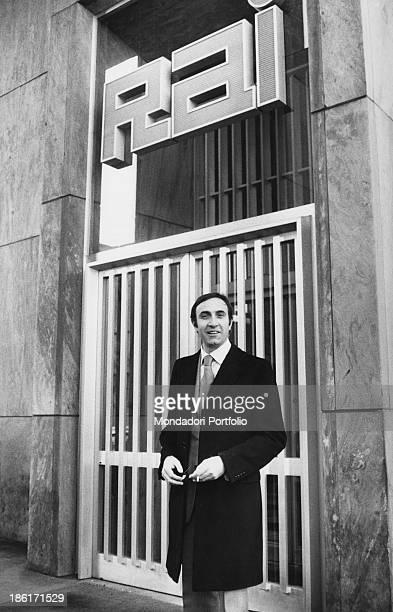 Italian actor and TV presenter Pippo Baudo standing in front of RAI studios in Corso Sempione. Milan, 1973.