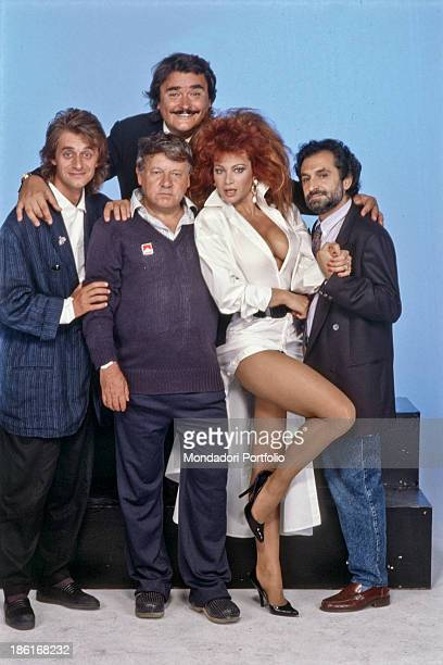 Italian actor and writer Paolo Villaggio posing with the cast of the TV show Un fantastico tragico venerdì Italian showgirl and dancer Carmen Russo...