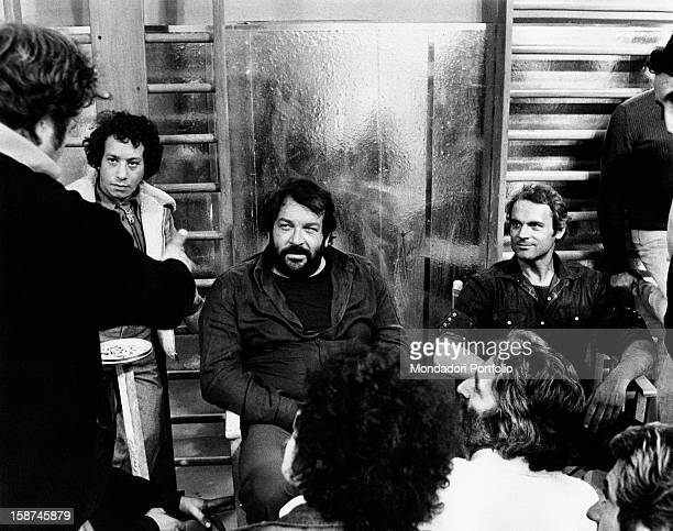 Italian actor Bud Spencer and Terence Hill listening to Italian director Marcello Fondato on the set of the film Watch Out We're Mad Rome 1974