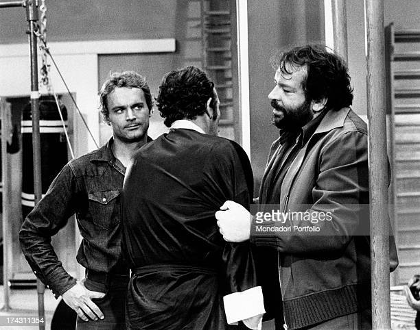 Italian actor Bud Spencer catching a man by the arm in the film Watch Out We're Mad Italian actor Terence Hill watches the scene as well Rome 1974