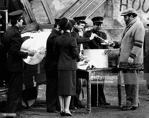 Italian actor Bud Spencer getting some food in a scene from the film Even Angels Eat Beans Beside him there are Italian actor Giuliano Gemma holding...