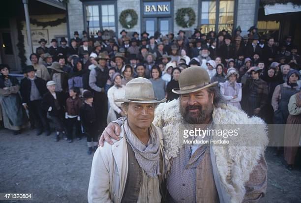 Italian actor Bud Spencer hugging Italian actor and director Terence Hill in front of many extras in the film Troublemakers Santa Fe 1994