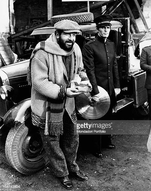 Italian actor Bud Spencer leaning on a car wing beside Italian actor Giuliano Gemma on the set of the film Even Angels Eat Beans. Rome, 1973