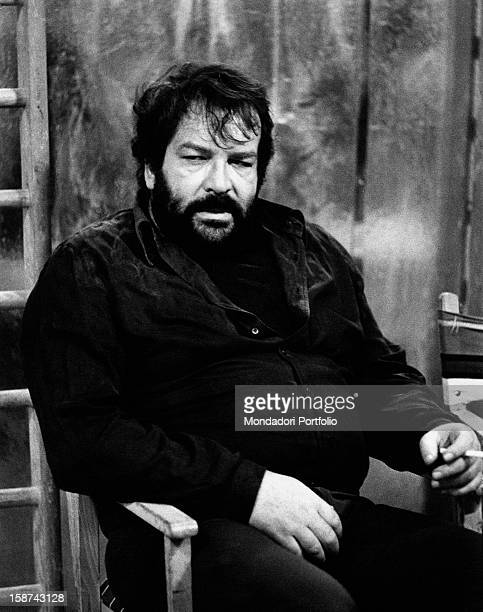Italian actor Bud Spencer smoking a cigarette sitting on a chair on the set of the film Watch Out We're Mad Rome 1974