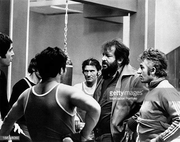 Italian actor Bud Spencer talking to some actors on the set of the film Watch Out We're Mad Rome 1974