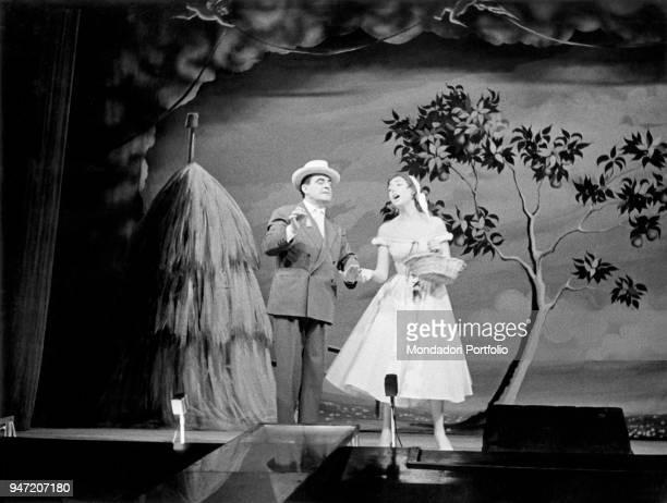 Italian actor Carlo Dapporto and Italian showgirl Delia Scala in the musical Giove in doppiopetto staged at Teatro lirico of Milan Milan October 1954