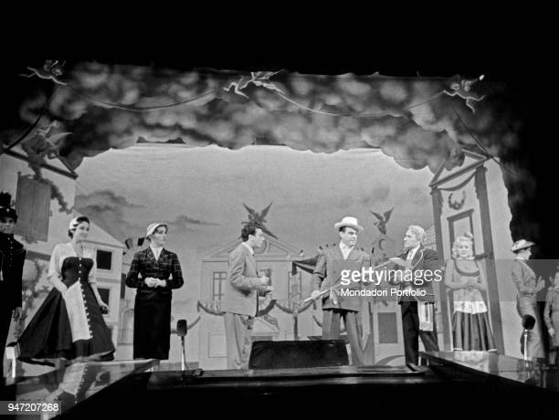 Italian actor Carlo Dapporto as Juppiter being welcomed with honours by the maior of Villapiana in the musical Giove in doppiopetto staged at Teatro...