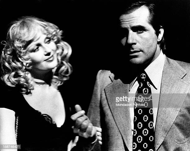 Italian actor Carlo Giuffré and American actress and model joking on the set of the movie La signora é stata violentata Rome 1970s