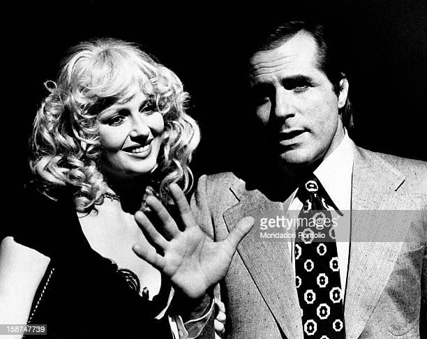 Italian actor Carlo Giuffré and American actress and model Pamela Tiffin joking on the set of the movie La signora é stata violentata. Rome, 1970s...