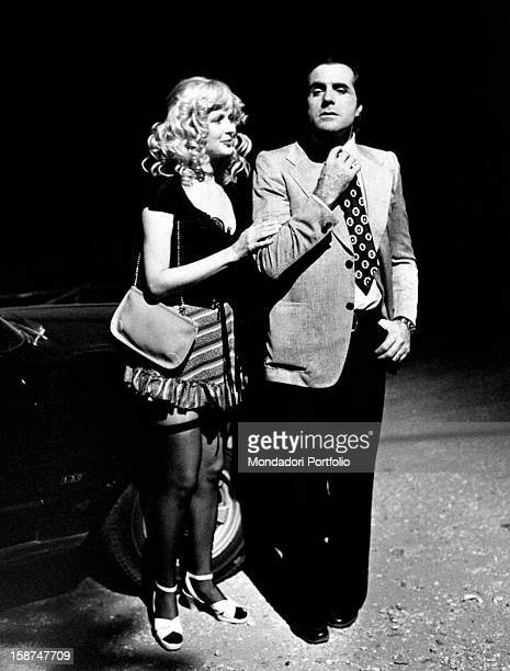 Italian actor Carlo Giuffré straightening his tie next to American actress and model Pamela Tiffin on the set of the movie La signora é stata...