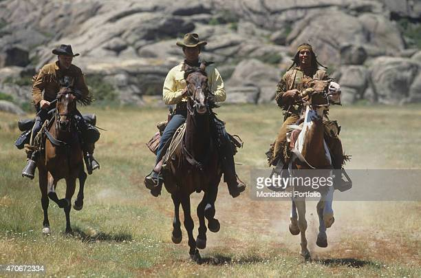 """Italian actor Carlo Mucari, Austrian actor William Berger and Italian actor Giuliano Gemma riding their horses in a scene from the film Tex and the..."