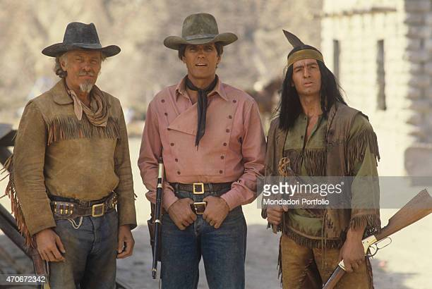 """Italian actor Carlo Mucari, Austrian actor William Berger and Italian actor Giuliano Gemma posing on the set of the film Tex and the Lord of the..."
