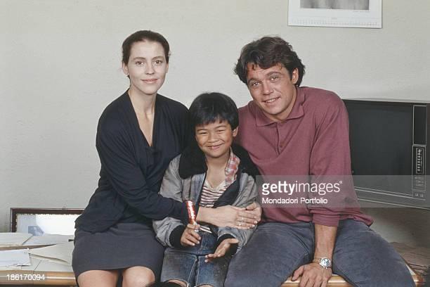 Italian actor Claudio Amendola and French actress Pascale Rocard hugging Filipino actor Victorr Torrefiel Vicente on the set of Felipe ha gli occhi...