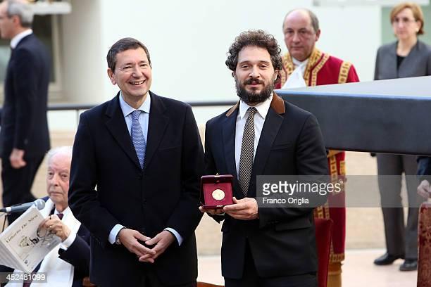 Italian actor Claudio Santamaria receives the Vittorio De Sica Awards 2013 from mayor of Rome Ignazio Marino at Esedra di Marco Aurelio Hall on...