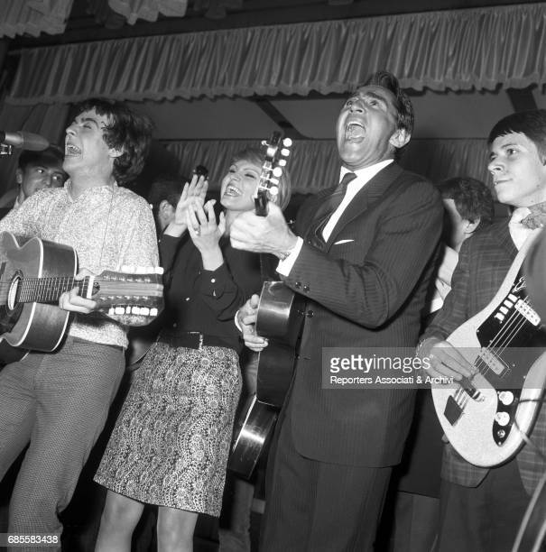 Italian actor comedian and TV host Walter Chiari and Italian actress Carmen Villani singing and playing music with her band Italy 1962