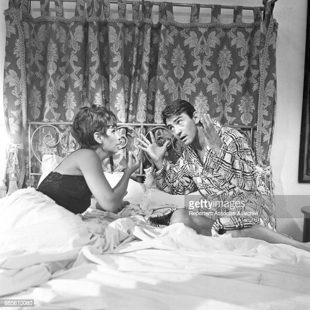 "Italian actor, comedian and TV host Walter Chiari and Italian actress Lea Massari arguing on a bed in the anthology movie directed by Nanni Loy ""Made..."