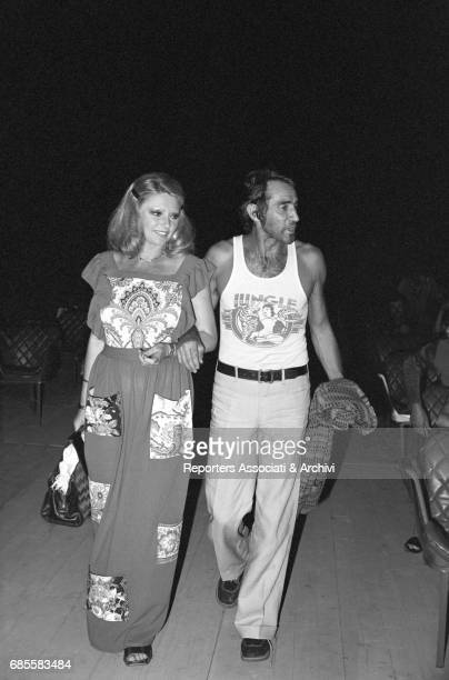 Italian actor comedian and TV host Walter Chiari arm in arm with Italian actress Sylva Koscina arriving in a theatre for the reharsals of a show...