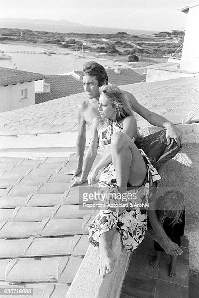 Italian actor comedian and TV host Walter Chiari on vacation in his Sardinian villa watching the panorama with his wife Italian actress and singer...