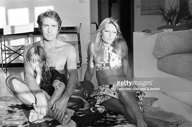 Italian actor comedian and TV host Walter Chiari portrayed in his Sardinian house while hugging his son Simone beside his wife and Italian actress...