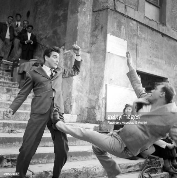 Italian actor comedian and TV host Walter Chiari punching a man in a scene from the movie 'La ragazza di Piazza S Pietro' Italy 26th March 1958