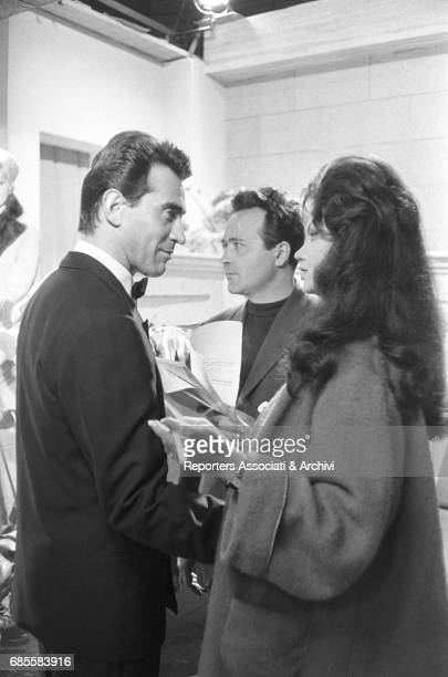 Italian actor comedian and TV host Walter Chiari with Cuban actress Chelo Alonso during a break on the set of La ragazza sotto il lenzuolo Italy 1961