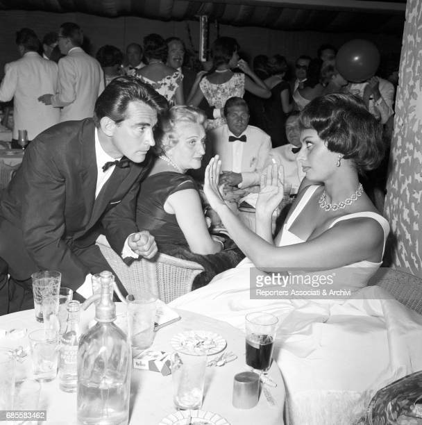 Italian actor comedian and TV host Walter Chiari with Italian actress Sofia Loren at a party Italy 1960