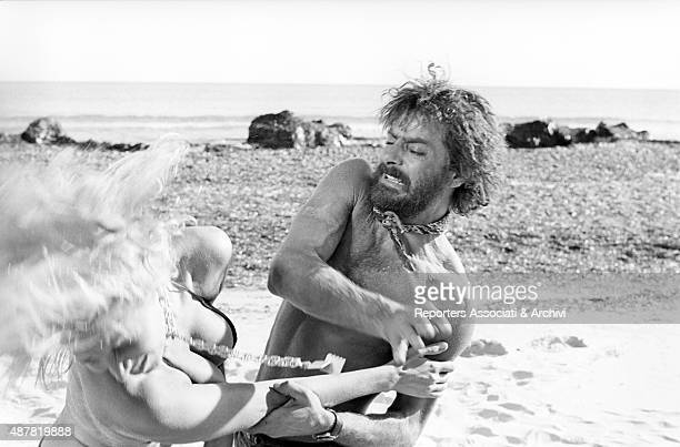 Italian actor director and scriptwriter Giancarlo Giannini slapping Italian actress Mariangela Melato in the film Swept away Italy 1974