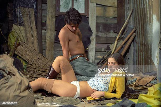 Italian actor director and scriptwriter Michele Placido looking at Italian actress Ornella Muti in the film Come Home and Meet My Wife Italy 1974