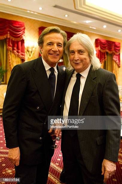 Italian actor director and singer Christian De Sica smiling beside Italian scriptwriter and producer Enrico Vanzina during the reception at the hotel...