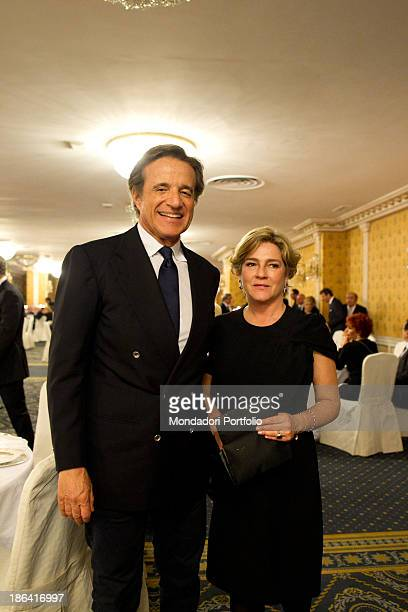Italian actor director and singer Christian De Sica smiling beside his wife Italian producer Silvia Verdone during the reception at the hotel Parco...