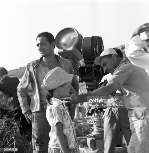 Italian actor, director, singer and scriptwriter Nino Manfredi waiting to begin the shooting while Italian director of photography Aldo Scavarda...