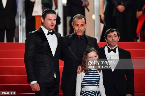 Italian actor Edoardo Pesce Italian director Matteo Garrone Italian actor Marcello Fonte and Italian actress Alida Baldari Calabria pose as they...