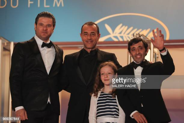 Italian actor Edoardo Pesce Italian director Matteo Garrone Italian actress Alida Baldari Calabria and Italian actor Marcello Fonte pose as they...