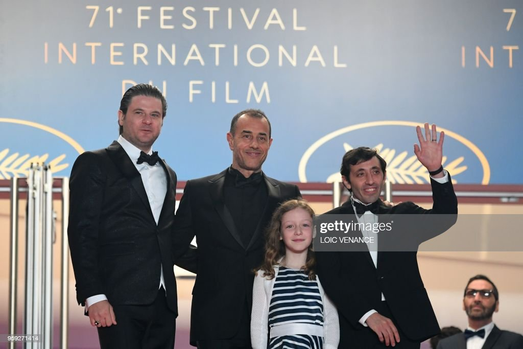 Italian actor Edoardo Pesce, Italian director Matteo Garrone, Italian actor Marcello Fonte and Italian actress Alida Baldari Calabria pose as they arrive on May 16, 2018 for the screening of the film 'Dogman' at the 71st edition of the Cannes Film Festival in Cannes, southern France.