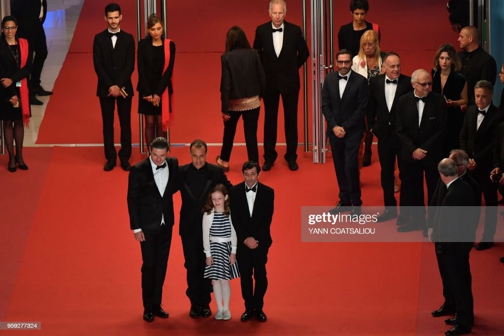 TOPSHOT - (FromL) Italian actor Edoardo Pesce, Italian director Matteo Garrone, Italian actor Marcello Fonte and Italian actress Alida Baldari Calabria pose as they arrive on May 16, 2018 for the screening of the film 'Dogman' at the 71st edition of the Cannes Film Festival in Cannes, southern France.