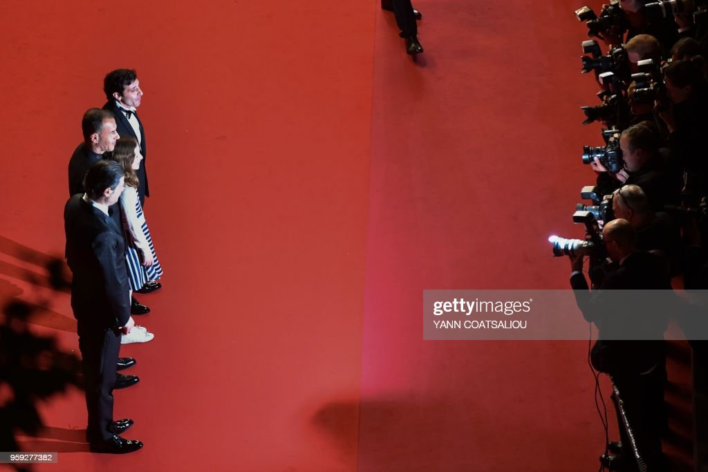Italian actor Edoardo Pesce, Italian director Matteo Garrone, Italian actress Alida Baldari Calabria and Italian actor Marcello Fonte pose as they arrive on May 16, 2018 for the screening of the film 'Dogman' at the 71st edition of the Cannes Film Festival in Cannes, southern France.