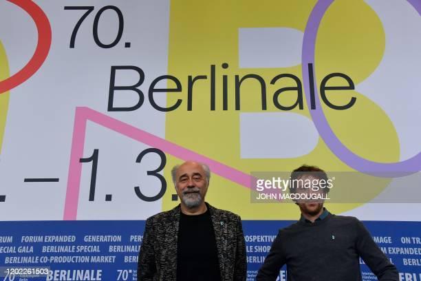 Italian actor Elio Germano and Italian director Giorgio Diritti pose during a press conference for the film Volevo Nascondermi screened in...
